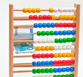 Abacus. Close view of an abacus with colored beads end Euro Stock Images
