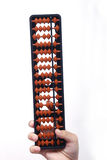 Abacus. Full shot of abacus over white background with hand stock photography
