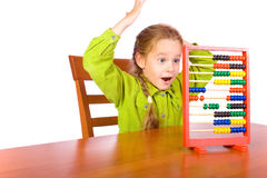 Abacus. Young girl with colorful abacus Royalty Free Stock Photography