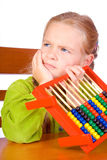 Abacus. Young girl with colorful abacus Stock Photography
