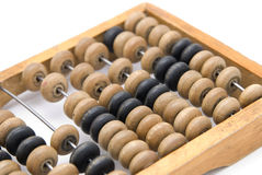 Abacus. Old wooden abacus in close shot against on the light background royalty free stock images