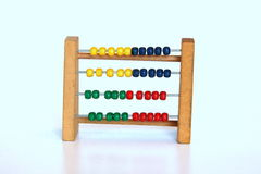 Abacus. Using a tiny abacus to count Stock Photos