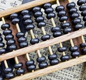 Abacus. Old Chinese abacus on whit background royalty free stock image