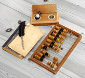 Abacus accounting wooden vintage pencil ink pot book office set. Write Royalty Free Stock Photo