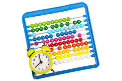 Abacus and alarm clock. As concept for back to basic Royalty Free Stock Image