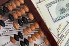 Abacus and american dollars. Royalty Free Stock Photography