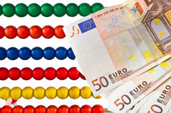 Abacus beads with euro Stock Images