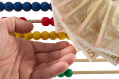 Abacus beads with euro Stock Image