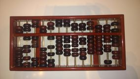Abacus. Beads is a simple calculation tool inventions of our ancestors,  beads originated in the Northern Song Dynasty, Song file string bead. The  is a simple Royalty Free Stock Photo