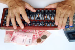 Abacus and Calculation and Taiwan Dollars Royalty Free Stock Images