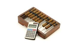 Abacus and calculator Royalty Free Stock Photos