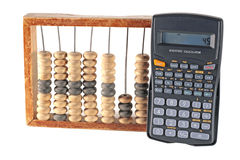 Abacus and calculator. An abacus and a modern calculator on a white background Stock Photos
