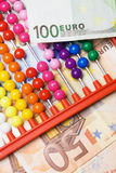 Abacus calculator and european money Stock Photography