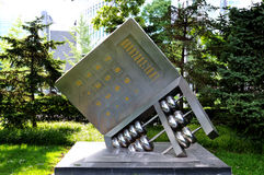 Abacus and calculator sculpture Stock Photos