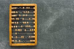 Abacus on chalkboard Stock Photo