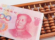 Abacus and china dollar Royalty Free Stock Photo
