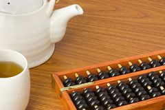 Abacus and chinese tea Stock Images