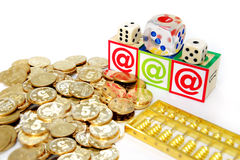 Abacus coins and dice Stock Photography