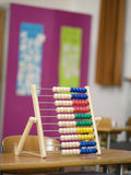 Abacus on desk Stock Photography