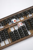 Abacus and dice. Chinese the traditional calculation toolsabacus and dice Stock Images