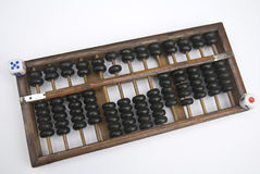 Abacus and dice. Chinese the traditional calculation tools abacus and dice Royalty Free Stock Photos