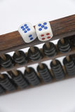 Abacus and dice. Chinese the traditional calculation tools abacus and dice Royalty Free Stock Image