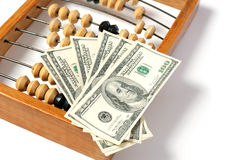 Abacus and dollar Royalty Free Stock Image