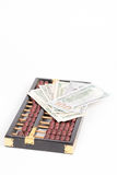 Abacus and dollar banknote Royalty Free Stock Images