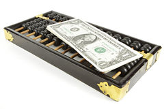 Abacus with dollar on isolate white Stock Photography