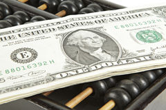 Abacus with dollar on isolate white Royalty Free Stock Photo