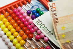 Abacus and european money Royalty Free Stock Image