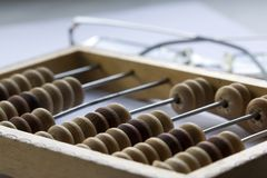 Abacus and glasses Stock Photography