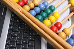 Abacus on a keyboard Stock Images