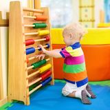 Abacus at kindergarten. Educational toys for kids Royalty Free Stock Image