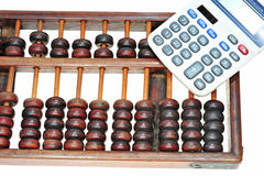 Abacus And Modern Calculator Royalty Free Stock Photo
