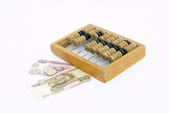Abacus with money Stock Image