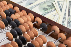Abacus and money. Stock Images