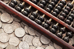 Abacus on money Royalty Free Stock Photography