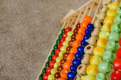 Abacus montessori with plastic fruits to learn mathematical operations
