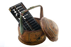 Abacus and old Chinese basket Stock Images