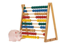 Abacus with pink piggy bank Royalty Free Stock Photography