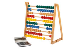 Abacus and a pocket calculator Royalty Free Stock Images