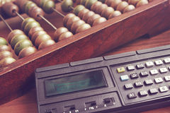Abacus and retro calculator Royalty Free Stock Images