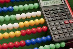 Abacus and scientific calculator Royalty Free Stock Images