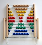 Cross sign with abacus beads. Making signs with colourful abacus beads royalty free stock photos
