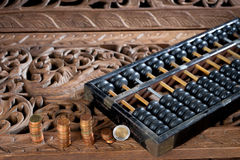 Abacus on Thai style teak wood carving Royalty Free Stock Images