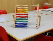 Abacus to learn how to count numbers based on decimal or base te. Wooden abacus to learn how to count numbers based on decimal or base ten stock photography
