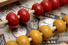 Abacus & U.S. currency Stock Photography