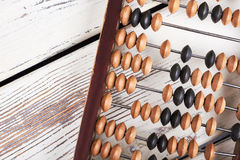 Abacus on wooden background. Royalty Free Stock Photos