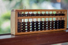 Abacus. On the wooden table Stock Images